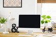 Leinwandbild Motiv White lamp next to computer desktop on wooden desk in home office interior with plant. Real photo