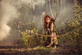 Fantasy medieval woman hunting in mystery forest - 214267374