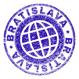 BRATISLAVA stamp print with grunge style. Blue vector rubber seal print of BRATISLAVA caption with corroded texture. Seal has words arranged by circle and globe symbol.