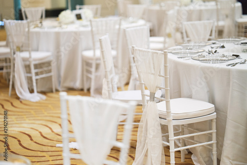 White chiavari chairs arrangement for wedding reception dinner table ...