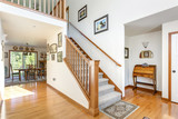 Foyer interior with grey staircase. - 214274554