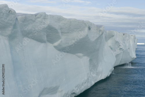 Foto Spatwand Antarctica An awesome view of a very large iceberg in the Arctic