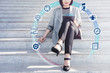 Business Managament Concept. Young Successfull Woman Working on Tablet at outdoor stair, surrounded by many Icons