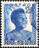 Woman portrait on vintage stamp of Papua new Guinea - 214333145