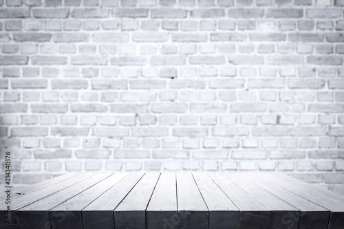 Leinwandbild Motiv table background of free space and white wall.