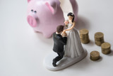 statuette of groom and bride with coins and dollars. Broken Pink pig money box on white background - 214343505