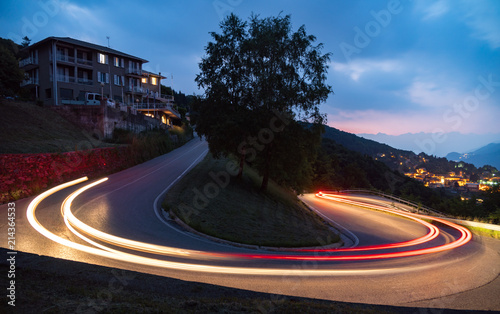 Aluminium Nacht snelweg light painting in mountains road cars fast alps view