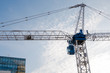 Tall Crane in a Construction Site against Blue Sky.