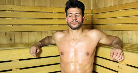 Man relaxing in a sauna © Minerva Studio