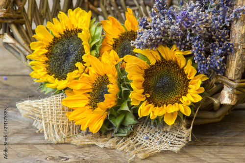 sunflowers and lavender in a basket - 214375385