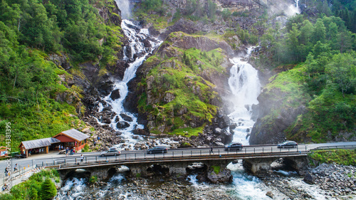 Aerial view of Latefossen. A waterfall located in the municipality of Odda in Hordaland County, Norway. - 214381395