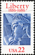 Statue of liberty head on american postage stamp