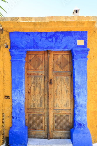 Historic door in street of old town Rhodes, Dodecanese, Greece