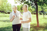 Funny joke. Happy aged positive woman laughing at the joke of her loving kind husband - 214397155
