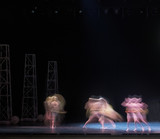 auditorium, view of the stage. ballet dancers silhouettes. Defocused entertainment concert lighting on stage.  - 214442176