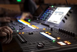 music, technology, people and equipment concept - hands using mixing console in sound recording studio - 214448164