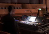 music, technology, people and equipment concept - hands using mixing console in sound recording studio - 214448398