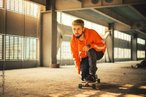 Hipster man enjoying ride on a long board