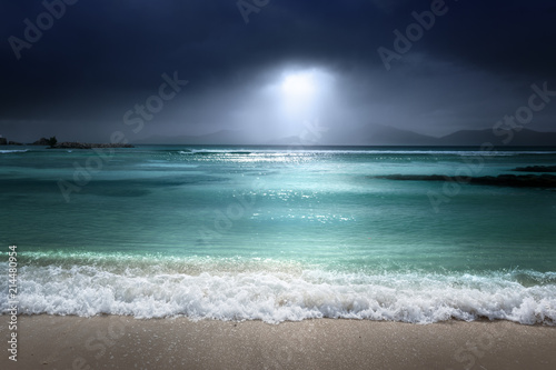 Plexiglas Tropical strand dark sky on the beach of la Digue island, Seychelles