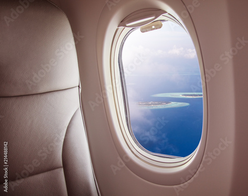 Airplane window with beautiful Maldives island view - 214488142