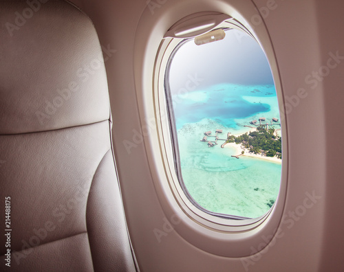 Airplane window with beautiful Maldives island view - 214488175