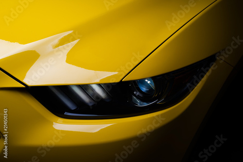 Car detailing series: Clean headlight of yellow sports car - 214501343