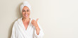 Leinwanddruck Bild - Beautiful middle age woman, wet hair wearing a towel pointing with hand and finger up with happy face smiling