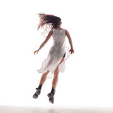 Young beautiful dancer is posing in studio - 214515380