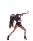 Young beautiful dancer is posing in studio - 214515775