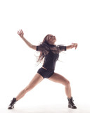 Young beautiful dancer is posing in studio - 214515786