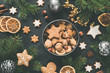 Leinwandbild Motiv New Year or Christmas box with sweets Gingerbread cookies, gingerbread stars, dried orange rings and fir tree. Top view. Christmas flat lay composition