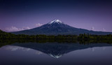 Mount Fuji reflected in the lake with a purple night sky - 214571931