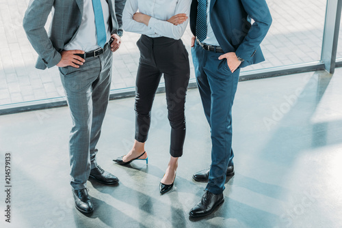 cropped shot of group of male and female business people at modern office