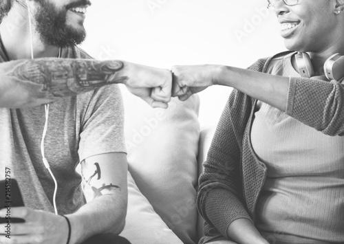 Leinwandbild Motiv Musicians fist bumping on a couch