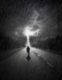 Man walking towards storm - 214588549