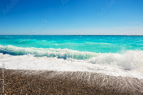 Foto Spatwand Nice Beautiful beach with turquoise sea in Nice, France.