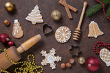 Christmas sweet food background with homemade cookies, spices, kitchen utensils. Top view on a brown old rusty metal table.
