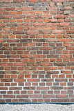 Old worn brick wall exterior pattern texture background