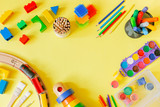 Day care concept - art supplies and toys on bright background - 214607397