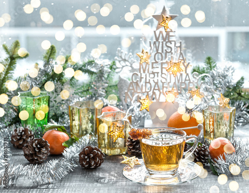 Foto Murales Christmas window decoration golden lights tea