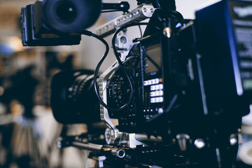 Modern video camera with microphone on blurred background © Zarya Maxim