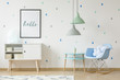 Quadro Scandi, blue boy room interior with a rocking chair, knot cushion, white cupboard and poster. Real photo