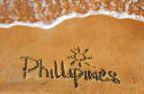 Phillipines word on sand beach background