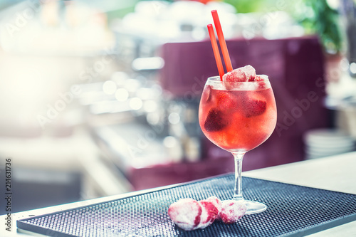 Canvas Sap Strawberry lemonade or alcoholic cocktail with ice syrup soda and mint leaves on bar table
