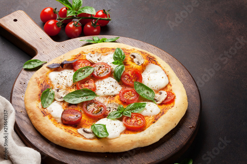 Italian pizza with tomatoes, mozzarella and basil - 214641357