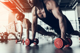Young Man and Woman Training in Fitness Club. - 214657508