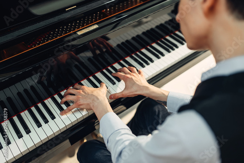 Pianist playing music on grand piano