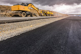 Repair of a road after a storm. By heavy machinery - 214661166