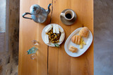 Traditional Crete breakfast, bread, cheese and coffee on wooden table on a kitchen. Crete, Greece