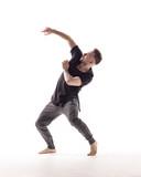 Young beautiful dancer is posing in studio - 214674568